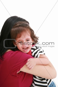 Little girl crying in mothers arm, isolated on white