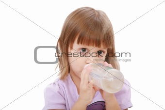 Little girl drinking water of her bottle. White background
