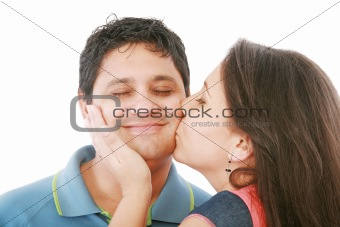 Nice girl kisses the young modest guy on a cheek
