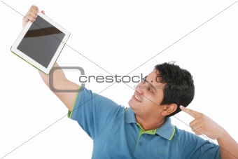 Laughing casual young man holding a touch pad tablet pc on isola