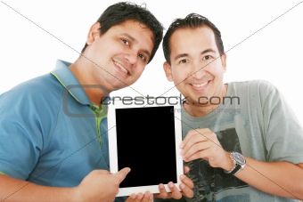 Two young men or businessmen showing a tablet PC computer and sm