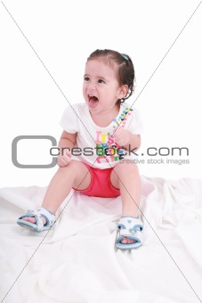 Portrait of emotional kid. Funny little girl isolated on white