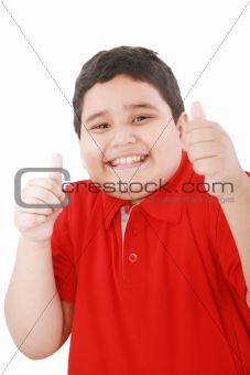 Thumbs up shown by a happy young boy