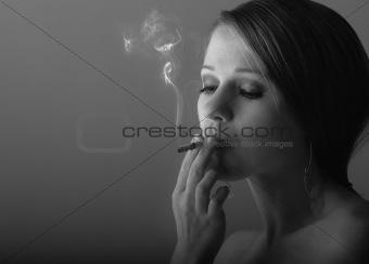 beautiful young woman smoking a cigarette