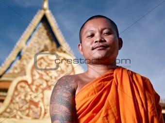 portrati of buddhist monk near temple, Cambodia, Asia