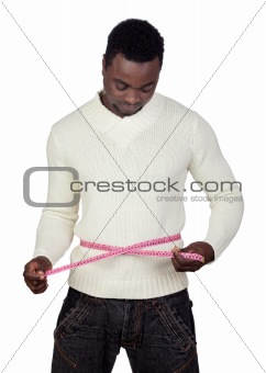 Attractive african man with a tape measure