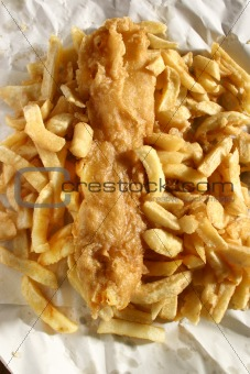 Battered fish and chips in paper