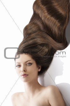 beauty young girl hairstyle, her face is sligtly torned at right