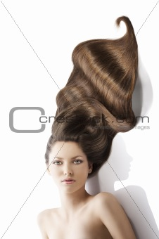 beauty young girl hairstyle, she is in front of the camera and l