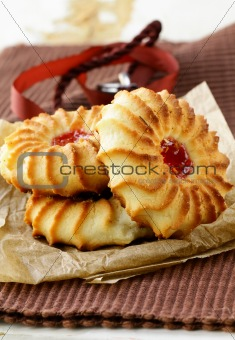 beautiful cookies with jam on a brown background