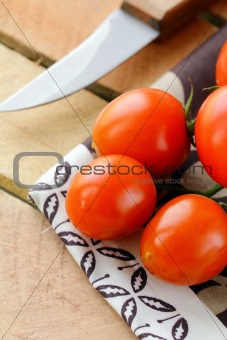 Tomatoes Cherry fresh ripe  on a  wooden board