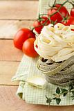 Italian pasta fettuccine with cherry tomatoes