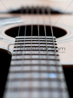Close-up of a guitar neck with all strings