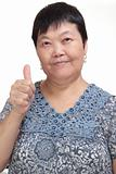 Happy Asian young woman give you an excellent gesture with friendly smiling face