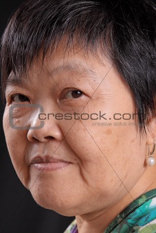 asian woman on black background