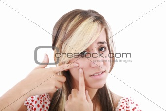 Acne facial care, teenage girl squeezing pimple
