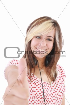 Smiling beautiful woman with thumbs up. Focus on the girl