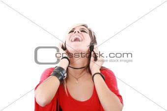 Young woman with a cool rocker style listening to music