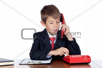 Little businessman dialing a red phone