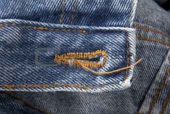 Blue jeans with buttonhole