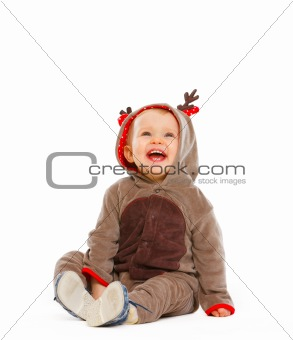 Portrait of lovely baby dressed as Santa Claus's reindeer