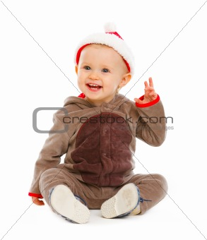 Portrait of smiling lovely baby in Santa hat