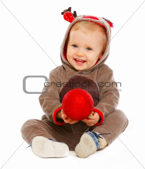 Portrait of lovely baby playing with Christmas ball