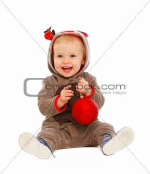 Portrait of happy lovely baby playing with Christmas ball