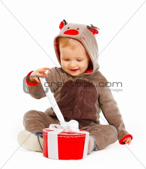 Portrait of happy cute baby opening Christmas present box