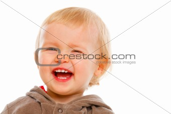 Portrait of winking adorable baby