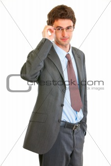 Portrait of confident modern businessman in eyeglasses