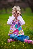 Little girl outdoors with imaginary binoculars