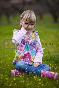 Little girl outdoors with imaginary binoculars