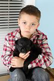 Boy and puppy