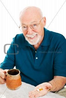 Senior Man Takes Supplements