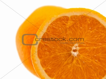 One half of orange with another whole orange beyond. On white.