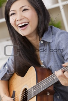 Beautiful Happy Chinese Oriental Asian Woman Smiling & Guitar