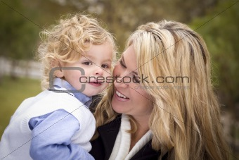 Attractive Mother and Cute Son Portrait Outside at the Park.