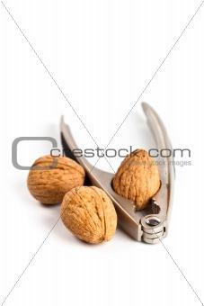 three walnuts and nutcracker