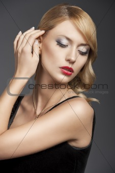 old fashion blond girl, she has right hand near the hair