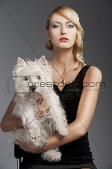 old fashion blond girl, with dog she looks in to the lens
