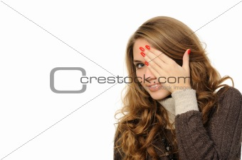 girl is gazing through her fingers