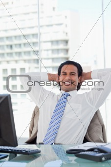 Portrait of a businessman relaxing in his office
