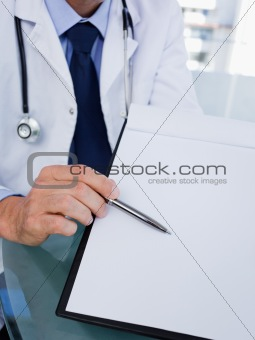 Close up of a male doctor showing a document