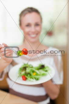 Salad being offered by woman