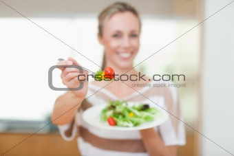 Tomato being offered by woman