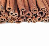 Horizontal background of cinnamon sticks