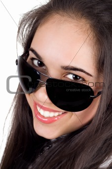 Portrait of the smiling girl in sunglasses. Isolated