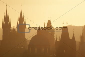 czech republic, prague - spires of the old town and tyn church on misty morning