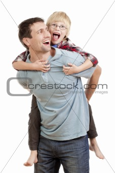 happy father giving his son piggy back ride - isolated on white